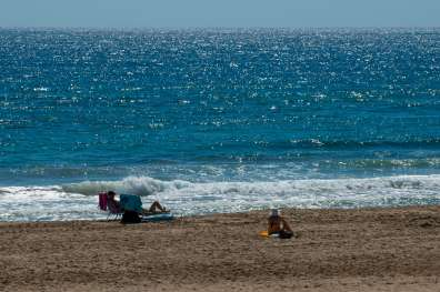 Mediterranean Sea, gentle waves, a broad, flat beach and fine, golden sand.